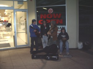 Chris & Brodie busking with friends