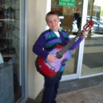 Enterprising young Hugh did a bit of busking for Christmas Eve shoppers